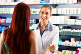 female pharmacist assisting the patient